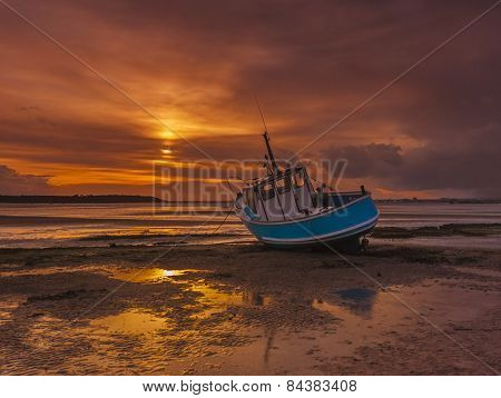 Fishing Boat Grounded At Low Tide In Poole Harbour