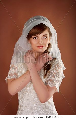 Beautiful Young Bride With Retro Hairstyle Wearing White Veil