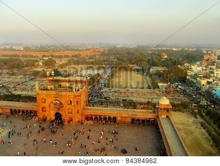 Delhi, India - January 23: Unidentified People Walk In The Courtyard Of Jama Masjid At Sunset On Jan