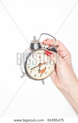 Hand holding a vintage clock over white background