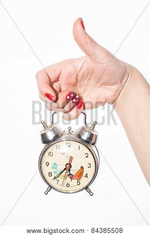 fingers holding retro watch over white background