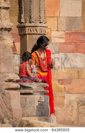 Indian Woman With A Child Standing At Quwwat-ul-islam Mosque, Qutub Minar, Delhi, India