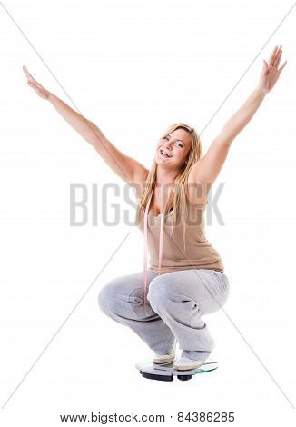 Girl On Scales Celebrating Weightloss