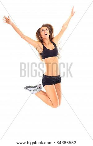 Fitness woman jumping excited isolated on white background.
