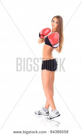 Portrait of young sporty woman wearing red boxing gloves.