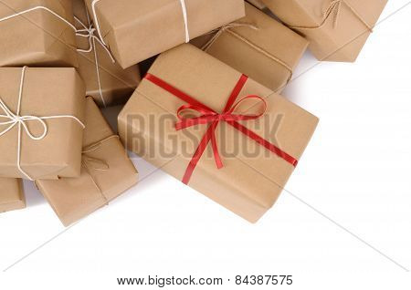 Group Of Parcels, One With Red Ribbon