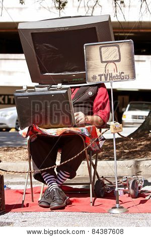 Street Performer Wears TV On Head At Maker Faire