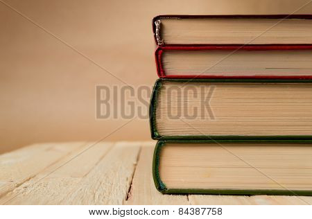 Four books on the wooden table