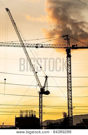 Silhouette Of Construction Site In Sunset.