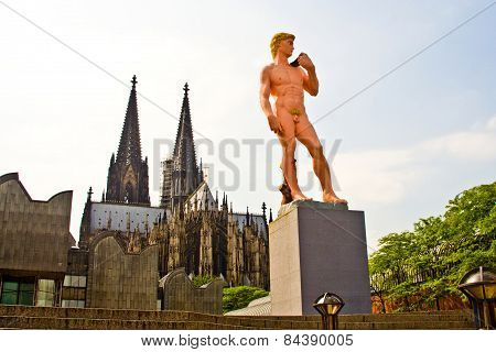 Adam From Michelangelo In Pink Is Standing In Front Of The Cologne Dome, Germany, Symbol For Homosex