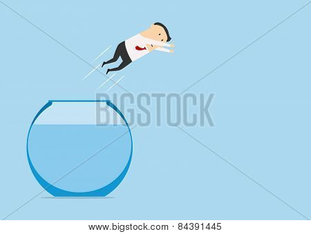 Businessman jumping in auarium