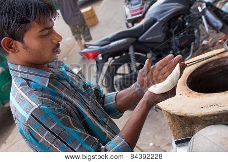 Delhi, India - November 5: Unidentified Man Makes Chapati At Streetside Restaurant On November 5, 20