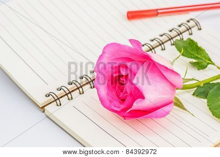 Pink Rose On Diary With Red Pen,valentines Day.