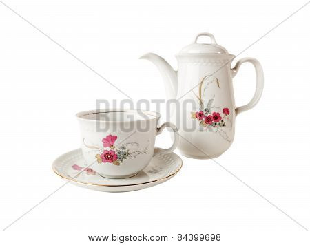 Porcelain Coffee pot, cup and saucer with floral patterns isolated over white background