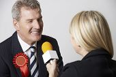 pic of politician  - Politician Being Interviewd By Journalist During Election - JPG