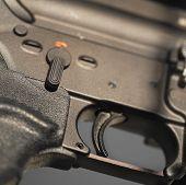 picture of gun shot  - Close up of a gun trigger - JPG