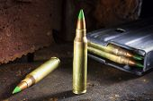 picture of piercings  - Cartridges considered armor piercing and a magazine  - JPG