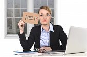 stock photo of frustrated  - young attractive frustrated businesswoman holding help message overworked at office computer exhausted desperate under pressure and stress with rainy sad window view  - JPG