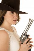 foto of pistols  - Tough cowgirl holding pistol looking far away - JPG