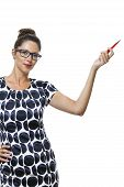 stock photo of ballpoint  - Portrait of Serious Woman with Eyeglasses Wearing a Printed Dress Holding a Red Ballpoint Pen - JPG