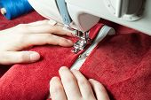 picture of sewing  - sewing a white zipper on a sewing machine - JPG