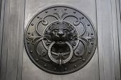 stock photo of metal sculpture  - A black metal palte with a lion - JPG