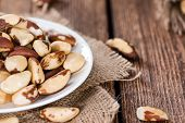 image of brazil nut  - Some Brazil Nuts on vintage wooden background - JPG