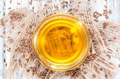stock photo of flax seed oil  - Portion of golden Linseed Oil with some seeds around - JPG