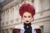 stock photo of gothic  - sexy woman with gothic makeup and red hair and castle - JPG