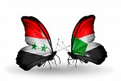 stock photo of sudan  - Two butterflies with flags on wings as symbol of relations Syria and Sudan - JPG
