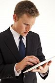 image of tablet pc computer  - Young businessman using a touch screen tablet type computer - JPG