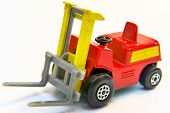 stock photo of lift truck  - Red and yellow industrial fork lift loader truck toy isolated on white - JPG