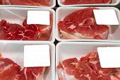foto of rayon  - Variety of meat slices in boxes in supermarket - JPG