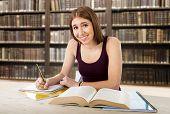 picture of exams  - young beautiful college student girl studying happy for university exam feeling relaxed and confident in successful youth education concept and academic success - JPG