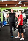 stock photo of personal trainer  - A shot of a male personal trainer assisting a male athlete training - JPG
