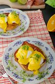 foto of benediction  - Eggs benedict prosciutto topped with Hollandaise sauce - JPG