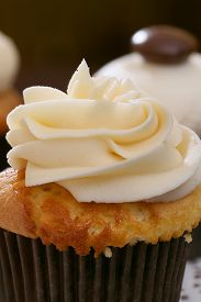 foto of sugarpaste  - Gourmet cupcakes baked and frosted with icing vanilla - JPG