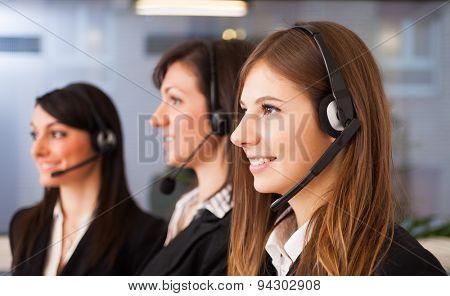 Portrait of three customer representatives at work
