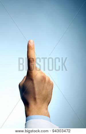 Doctor hand showing sign on blue background