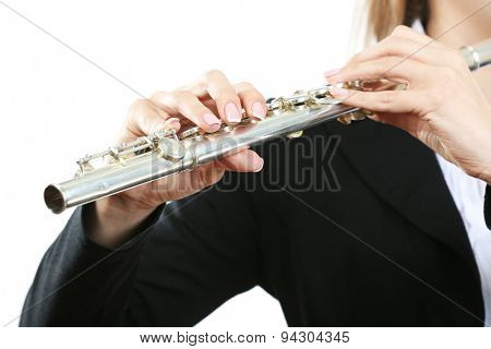 Musician playing flute isolated on white