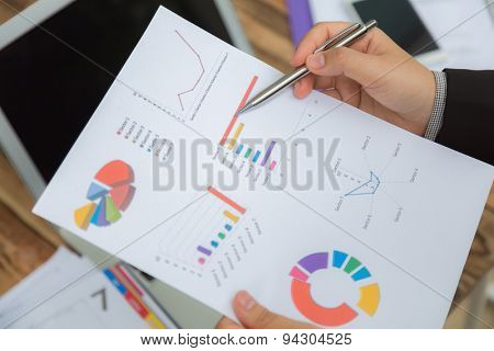 Business people pointing at business document during meeting
