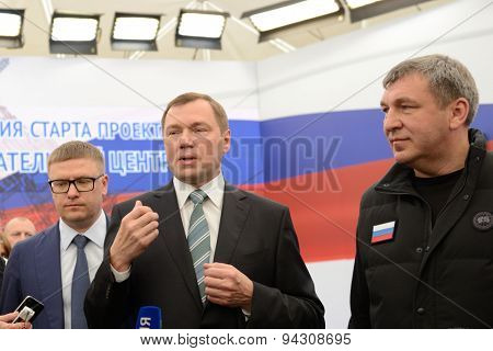 ST. PETERSBURG, RUSSIA - JUNE 20, 2015: General director of JSC Rosseti Oleg Budargin (center) talks with press during the presentation of project of the Federal Test Center for electrical equipment