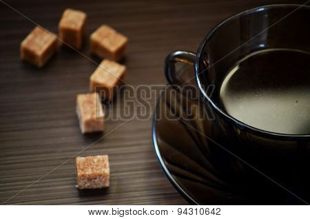 refined sugar in the form of a question mark and a  coffee