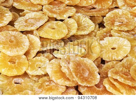 Dried pineapples fruits background