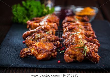 Spicy BBQ chicken wings with herbs and dips