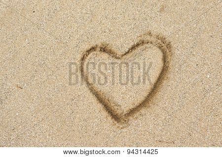Heart Shape Drawing On A Sand Beach