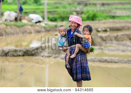 H'mong ethnic minority woman with her child in Mucangchai, Vietnam
