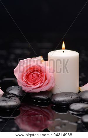 rose with candle and therapy stones