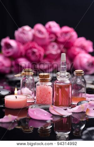 Branch pink rose and massage oil ,candle and therapy stones