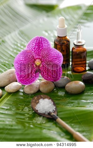 Spa set on banana leaf with salt in spoon ,stones